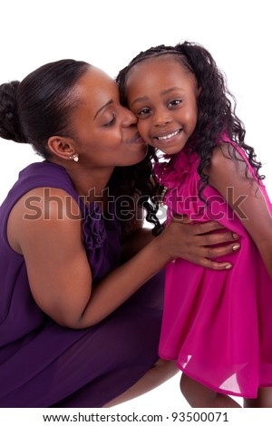 Happy african mother kissing her daughter, isolated on white background - stock photo