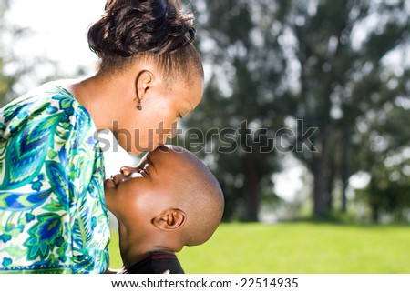 happy african mother kissing son - stock photo