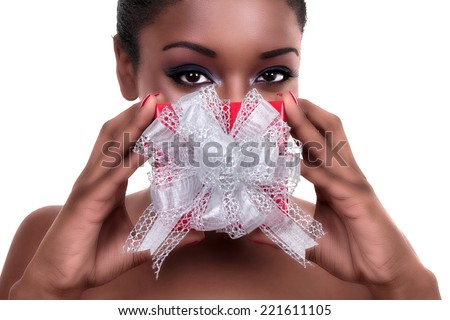 Happy African woman with gift present for Christmas or Valentine - stock photo
