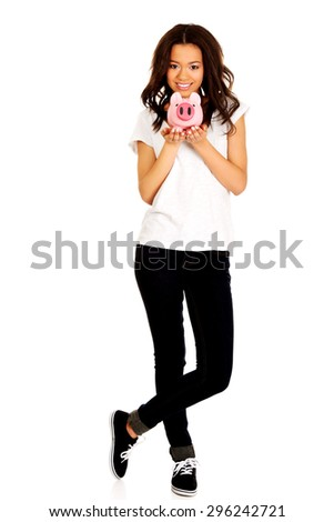 Happy african woman with piggybank. - stock photo