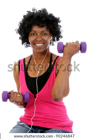 Happy African woman working out with gym weights and listening to music on earphones