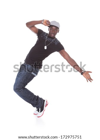 Happy African Young Man Dancing Over White Background - stock photo