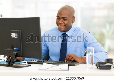 happy afro american business man using computer - stock photo