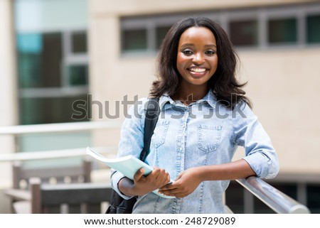 happy afro american college student holding a book - stock photo