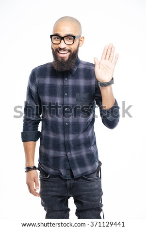 Happy afro american man waving hand at camera isolated on a white background - stock photo