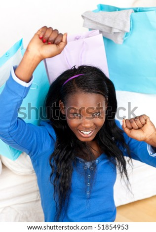 Happy Afro-American woman punching the air in celebration after shopping - stock photo