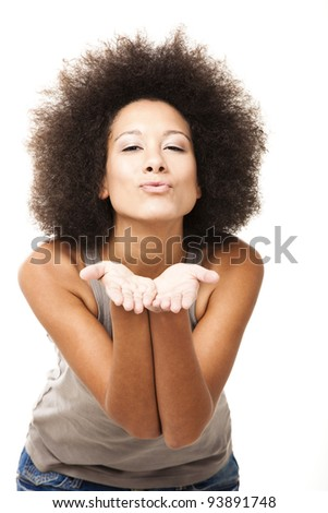 Happy Afro-American young woman isolated on white blowing a kiss