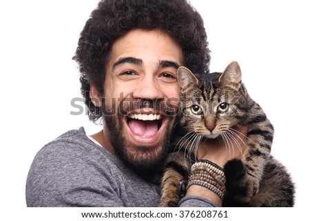 Happy afro man with cat - stock photo