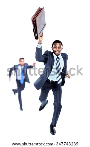 Happy afroamerican man running with a briefcase in hand. in the background-  his colleague, trying to catch up him - stock photo