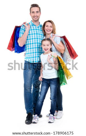 Happy american family with child holding shopping bags - over white background - stock photo