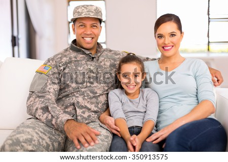 happy american military family relaxing at home - stock photo