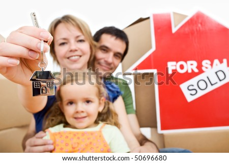 Happy an proud new homeowners - family moving in their home concept - stock photo
