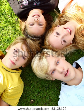 Happy and attractive family have healthly stroll in park - stock photo