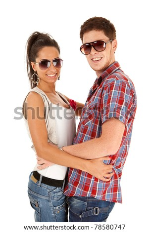happy and attractive man and woman couple wearing sunglasses and smiling