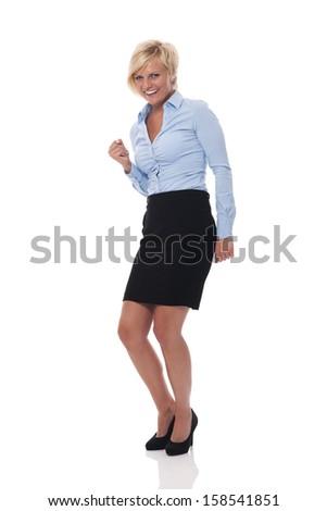 Happy and beautiful businesswoman cheering   - stock photo