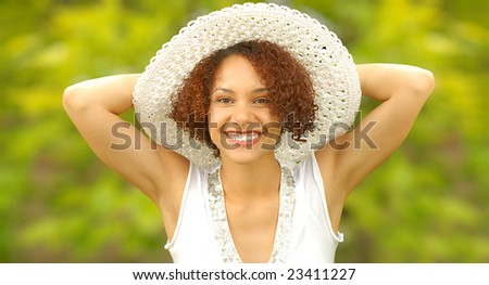 Happy and bright summer portrait taken outdoors - stock photo