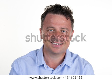 Happy and cheerful man smiling confidently isolated on a white - stock photo