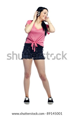 Happy and confident young woman listening to music in the moment laughing - stock photo