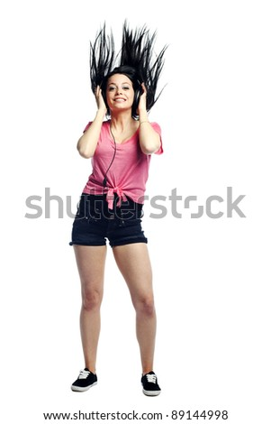 Happy and confident young woman listening to music in the moment with hair up - stock photo