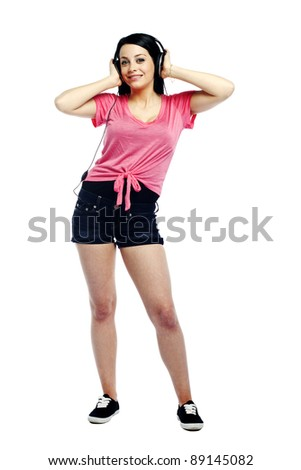 Happy and confident young woman listening to music on white background - stock photo