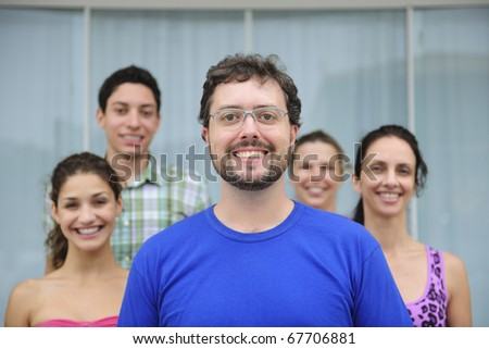 happy and diverse group of casual real people, mid adult man in front - stock photo