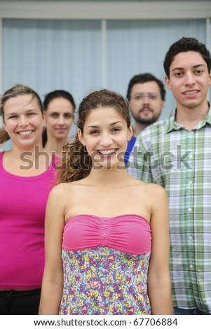 happy and diverse group of casual real people, teenage girl in front - stock photo