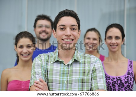 happy and diverse group of casual real people, young man in front - stock photo