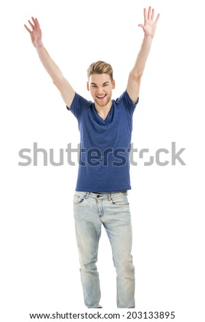 Happy and good looking young man with both arms up, isolated on white background - stock photo