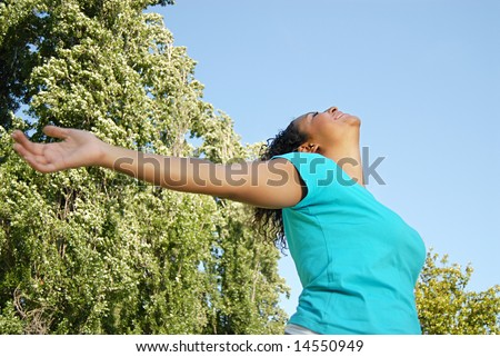 Happy and healthy young woman relaxing with open arms - stock photo