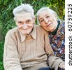Happy and joyful old senior couple outdoor - stock photo