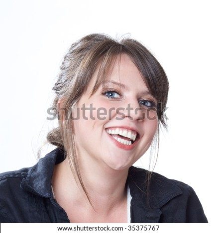 Happy and laughing young woman; head and shoulders shot; isolated on a white background. - stock photo