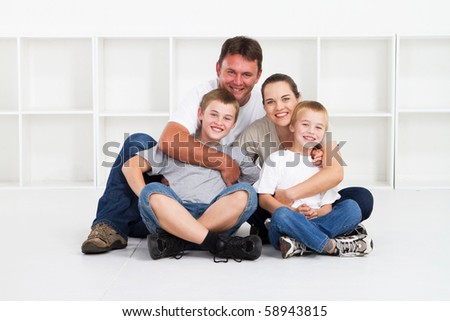 happy and loving family of four - stock photo