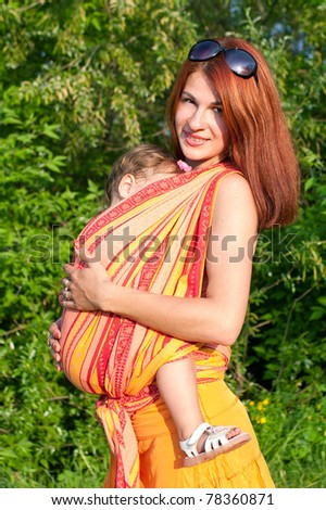 happy and loving one another, mother and daughter on a meadow