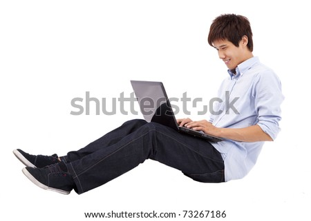 Happy and relax young man using laptop on the floor isolated on white background - stock photo