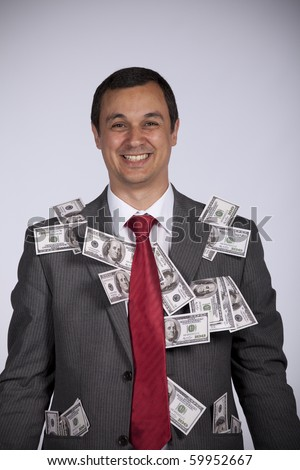 Happy and rich businessman showing all his money - stock photo