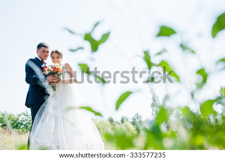 happy and smiled bride with groom