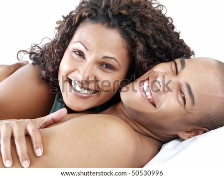 happy and smiling couple in bed - stock photo
