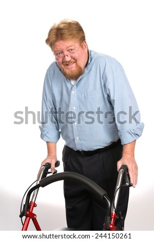 Happy and smiling disabled man uses a walker to maintain his balance. - stock photo