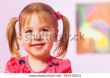 Happy and smiling portrait of girl with ponytails  - stock photo