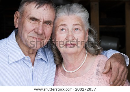 Happy and smiling senior couple in love. Happy couple portrait, closeup. Elderly couple walking. Mature couple walking in garden