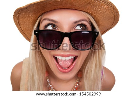 Happy and smiling young woman in sunglasses and summer hat. Blonde hair, light brown eyes, mouth wide open. Girl is excited about summer vacation (holidays). Close up