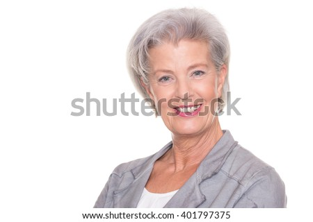 Happy and successful senior woman in front of white background - stock photo