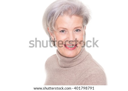 Happy and successful senior woman with pullover in front of white background