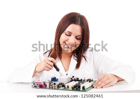 Happy and successful young computer technician - stock photo