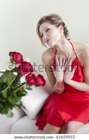 Happy and surprised woman receiving red roses on Valentine's Day or Birthday or Wedding Anniversary - stock photo