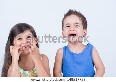 Happy and unhappy kids - stock photo