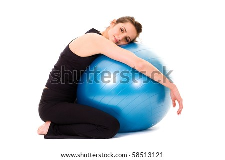happy and very attractive woman with blue fitness ball, studio shoot isolated on white background - stock photo