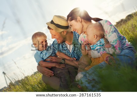 happy and young family spending time in the park - stock photo