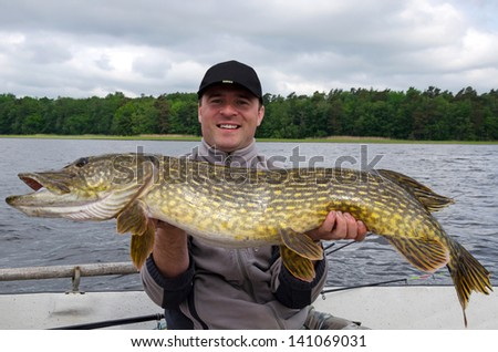 Happy angler with monster pike