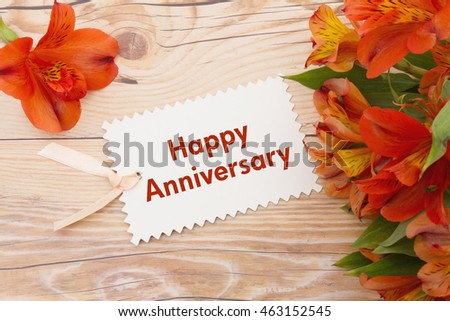 Happy anniversary greeting some lilies on stock photo 463152545 happy anniversary greeting some lilies on weathered wood with happy anniversary gift card and copy negle Images